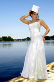 Bride River. A bride standing next to river in her dress Royalty Free Stock Image