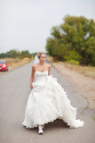 Bride on the road Royalty Free Stock Image