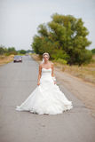 Bride on the road. A bride along on the road Royalty Free Stock Photo
