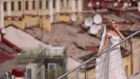 Bride at the roof. In the city stock video