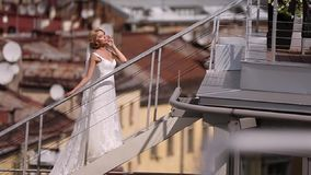 Bride at the roof. In the city stock video footage