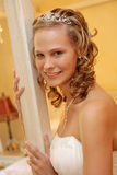 Bride Room. A bride on her wedding day standing next to bed Royalty Free Stock Image