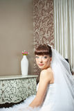 Bride in room with floral design Royalty Free Stock Images