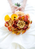 Bride with Rose Bouquet. Close Up of a Rose Bouquet on a Bride's Dress Stock Image