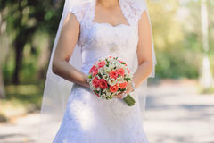 Bride with Roses in Park Stock Photo