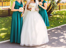 Bride, row of bridesmaids with bouquets at big wedding ceremony. Royalty Free Stock Photo