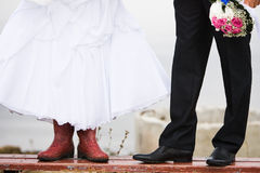 The bride in rubber boots.  royalty free stock photo