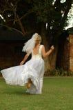 Bride running away stock images