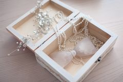 Bride`s accessories in a light wooden box stock images