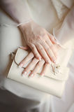 Brides arms Stock Photography