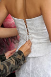 Bride's back. Preparing for wedding royalty free stock photography