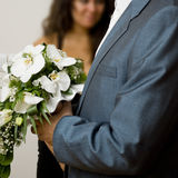 Bride's bouquet. Groom hold the bouquet from orchids for bride Royalty Free Stock Images