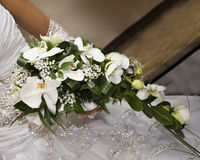 Bride's bouquet. Bride hold the bouquet from orchids Royalty Free Stock Photo