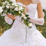 Bride's bouquet. Bride hold the bouquet from orchids royalty free stock photos