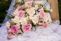 Bride's bouquet. Bride hold the bouquet from pink roses and carnations Stock Image