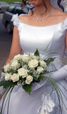 Bride's bouquet. Woman holding her bouquet of white roses Stock Photos