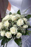 Bride's bouquet. Woman holding her bouquet of white roses Stock Photography