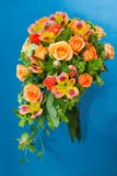 Bride's bouquet. Bouquet of flowers on blue background Stock Photography
