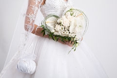 Bride's Bouquet. Bride's hands with a bouquet royalty free stock photo