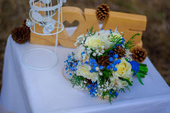 The bride`s bouquet. Bridal bouquet. The bride`s bouquet. Beautiful bouquet of white, blue, pink flowers and greenery, decorated with long silk ribbon, lies on Stock Photography