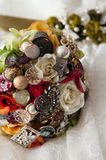 Bride's Bouquet. The bridal broach bouquet laying on the wedding gown Royalty Free Stock Photo