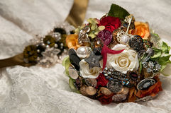The Bride's Bouquet. The bridal bouquet laying on the wedding gown Royalty Free Stock Images