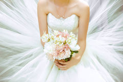 The bride's bouquet. Bridal bouquet in the lush dress in hands Royalty Free Stock Images