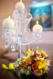 The bride's bouquet. Bridal bouquet on the table against the background of candles Royalty Free Stock Images