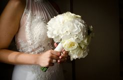 Bride`s bouquet. In the vase on the glass table with reflection Royalty Free Stock Photos