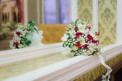 Bride bouquet. Of colorful flowers lying near the mirror royalty free stock photography