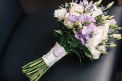 The bride's bouquet. On dark backgraund Stock Image
