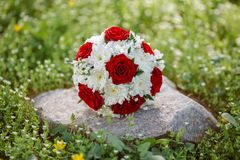 Bride's Bouquet on Green Grass Royalty Free Stock Photography