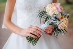 The bride's bouquet. Bouquet in hands of the bride Stock Photo
