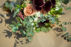 Bride's Bouquet on Sand Royalty Free Stock Image