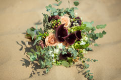 Bride's Bouquet on Sand Stock Image