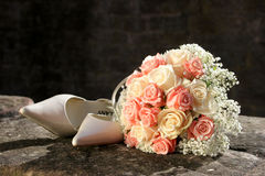 Bride´s bouquet an shoes. Bride's bouquet and shoes, wedding concept Royalty Free Stock Image