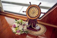 Bride's bouquet and steering wheel royalty free stock photo