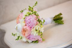Bride's Bouquet on Table. Still Life of Bride's Pink Orange and White Bouquet Stock Photo