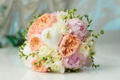 Bride's Bouquet on Table. Still Life of Bride's Pink Orange and White Bouquet Stock Photos