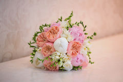Bride's Bouquet on Table. Still Life of Bride's Pink Orange and White Bouquet Royalty Free Stock Photos
