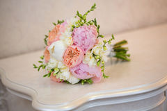 Bride's Bouquet on Table. Still Life of Bride's Pink Orange and White Bouquet Royalty Free Stock Image