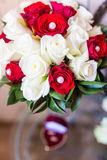 Brides bouquet. On a table. wedding rings Royalty Free Stock Images