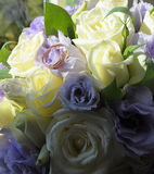 The bride's bouquet. Wedding rings on bride's bouquet Stock Photo