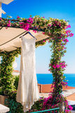 The bride`s dress on a hanger in the green Stock Photo