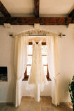 The bride`s dress hangs on the cornice Royalty Free Stock Photo