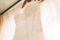 The bride`s dress hangs on the cornice Royalty Free Stock Images