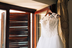The bride`s dress hangs on the cornice Royalty Free Stock Photos