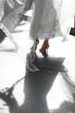 Bride's Dress with Shadow. Bride dancing in white wedding gown with shadow on floor stock photography