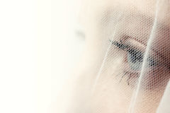 Bride's eye behind veil Royalty Free Stock Photography