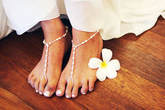 Bride's feet. Close-up of a bride wearing bead sandals on her feet Stock Images